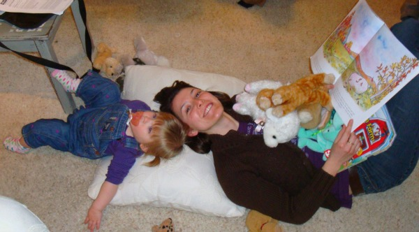 Maria sharing her books and toys with Aunt Kallie
